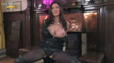Miss Hybrid big tits bursting free from leather dress, boots and gloves.